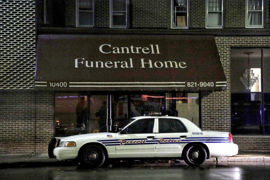 A Detroit Police vehicle was parked outside of the former Cantrell Funeral Home in Detroit on Friday, Oct. 12, 2018. Police found the decomposed bodies of 11 infants in the ceiling Friday.