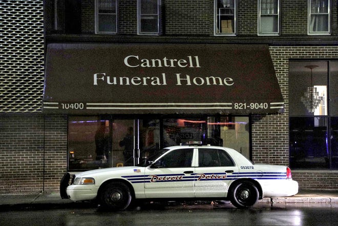 A Detroit Police vehicle was parked outside of Cantrell Funeral Home in Detroit on Friday, Oct. 12, 2018. Police found the decomposed bodies of 11 infants in the ceiling Friday.