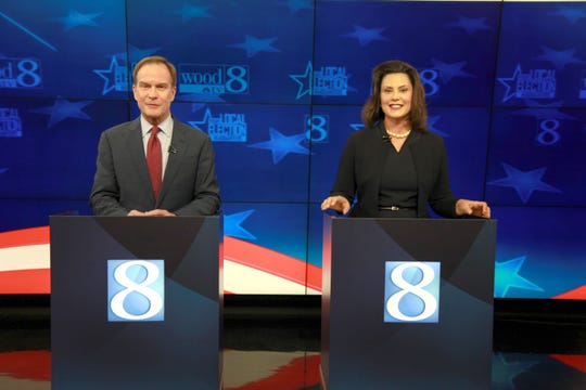 Candidates for the governor of Michigan, Republican Bill Schuette and Democrat Gretchen Whitmer, during the debate at WOOD TV in Grand Rapids on Friday, Oct. 12, 2018.