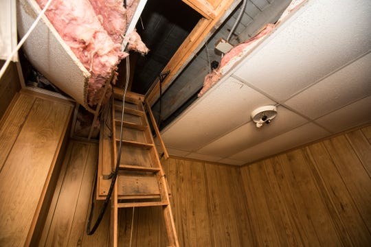 The badly decomposed bodies of 11 infants were found Friday, Oct. 12, 2018, inside the false ceiling on each side of the attic ladder at the former Cantrell Funeral Home in Detroit. The picture was taken Saturday, Oct. 13, 2018.
