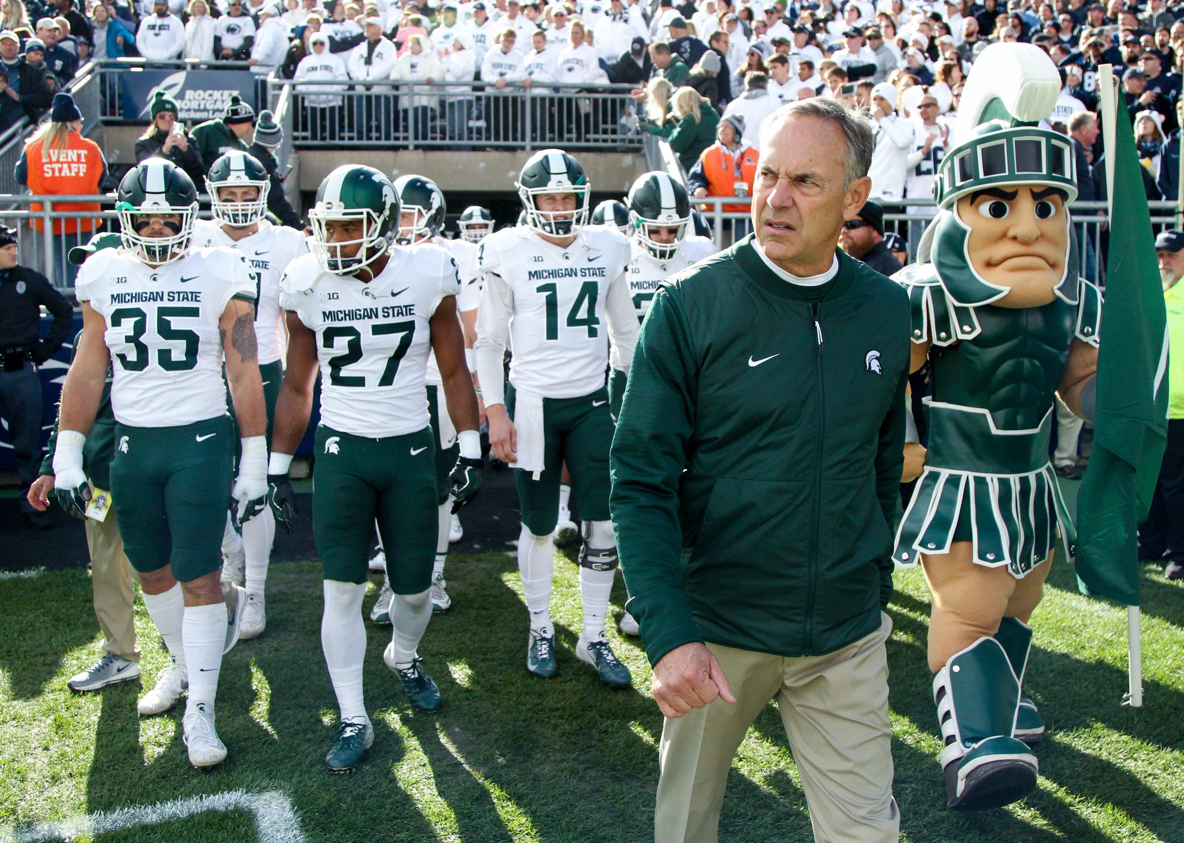 Michigan State coach Mark Dantonio leads his team onto the field prior to the game on Saturday, Oct. 13, 2018, in University Park, Pa.