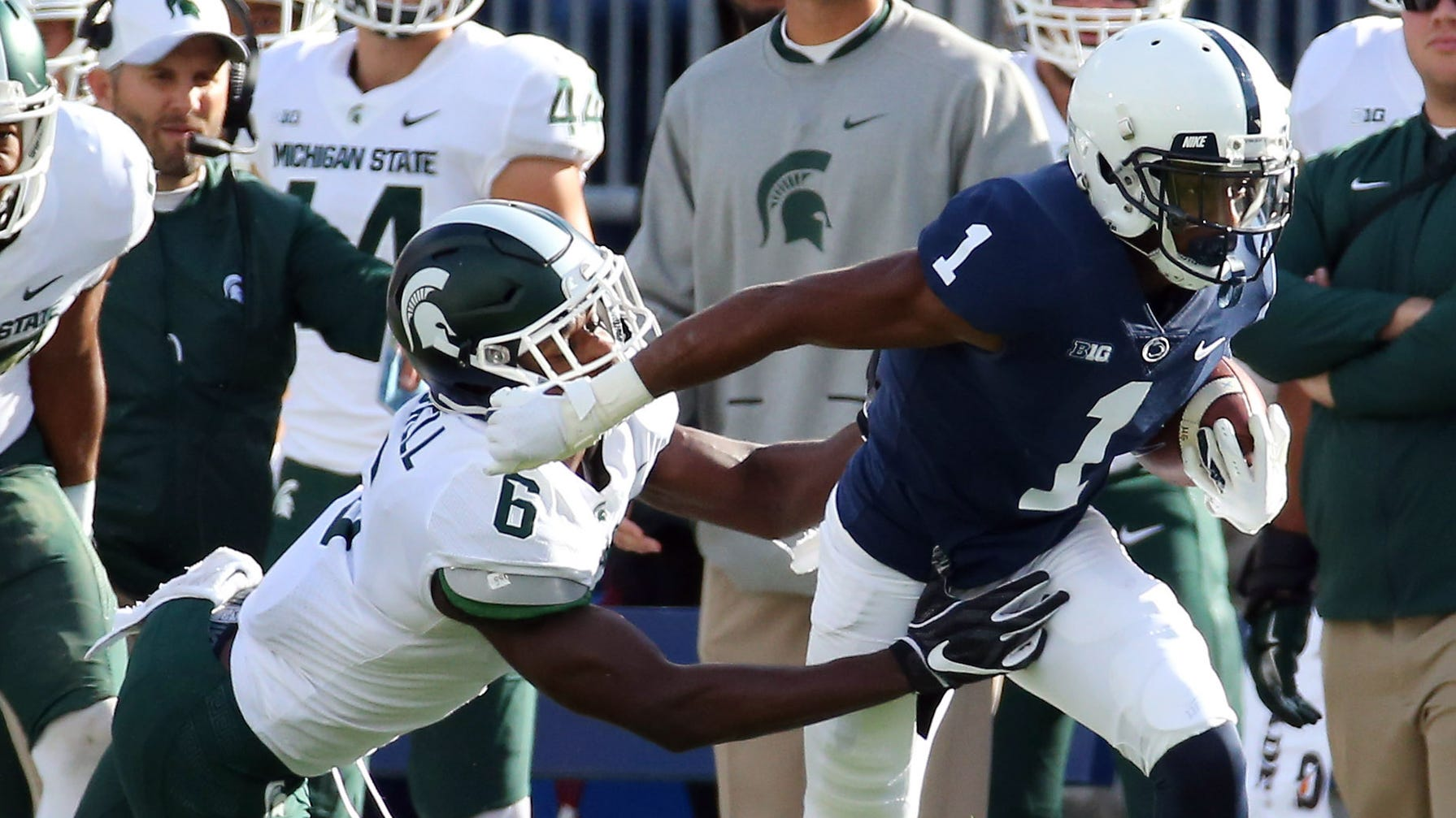 Penn State wide receiver KJ Hamler runs with the ball after a catch as Michigan State safety David Dowell defends during the first quarter on Saturday, Oct. 13, 2018, in University Park, Pa.