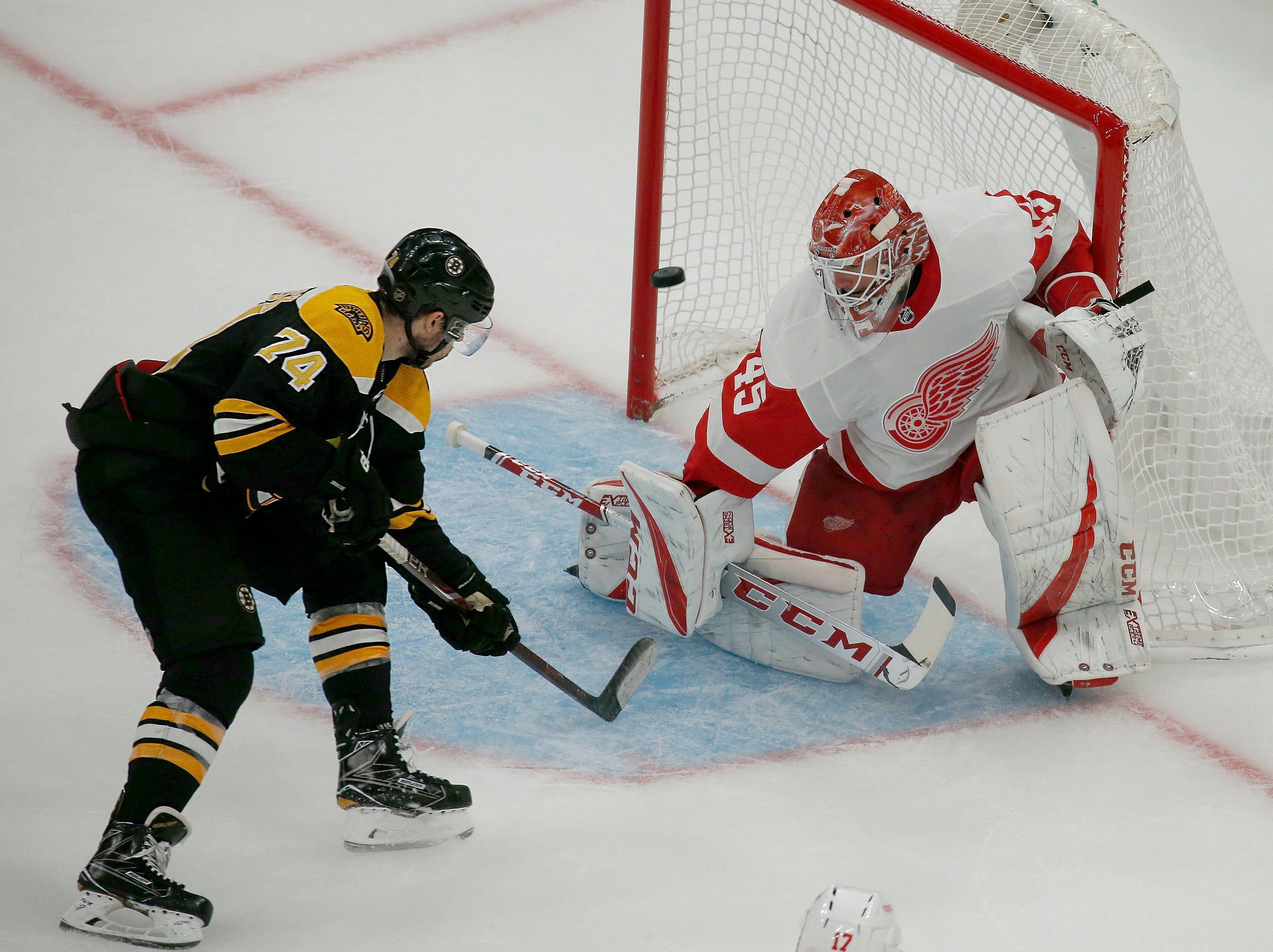 Boston Bruins left wing Jake DeBrusk (74) scores against Detroit Red Wings goaltender Jonathan Bernier (45) during the third period.