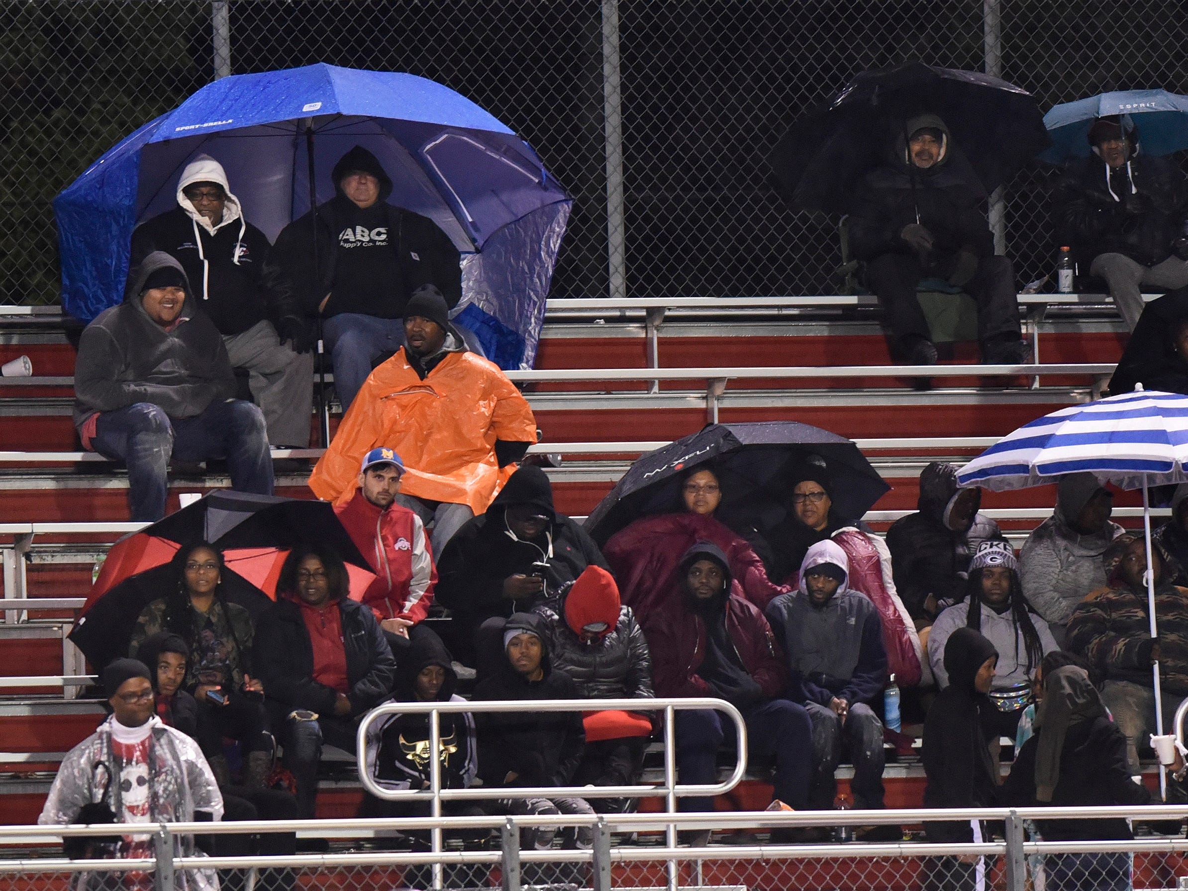Oak Park fans braved the cold and rain as they watched their team play against West Bloomfield in the fourth quarter.