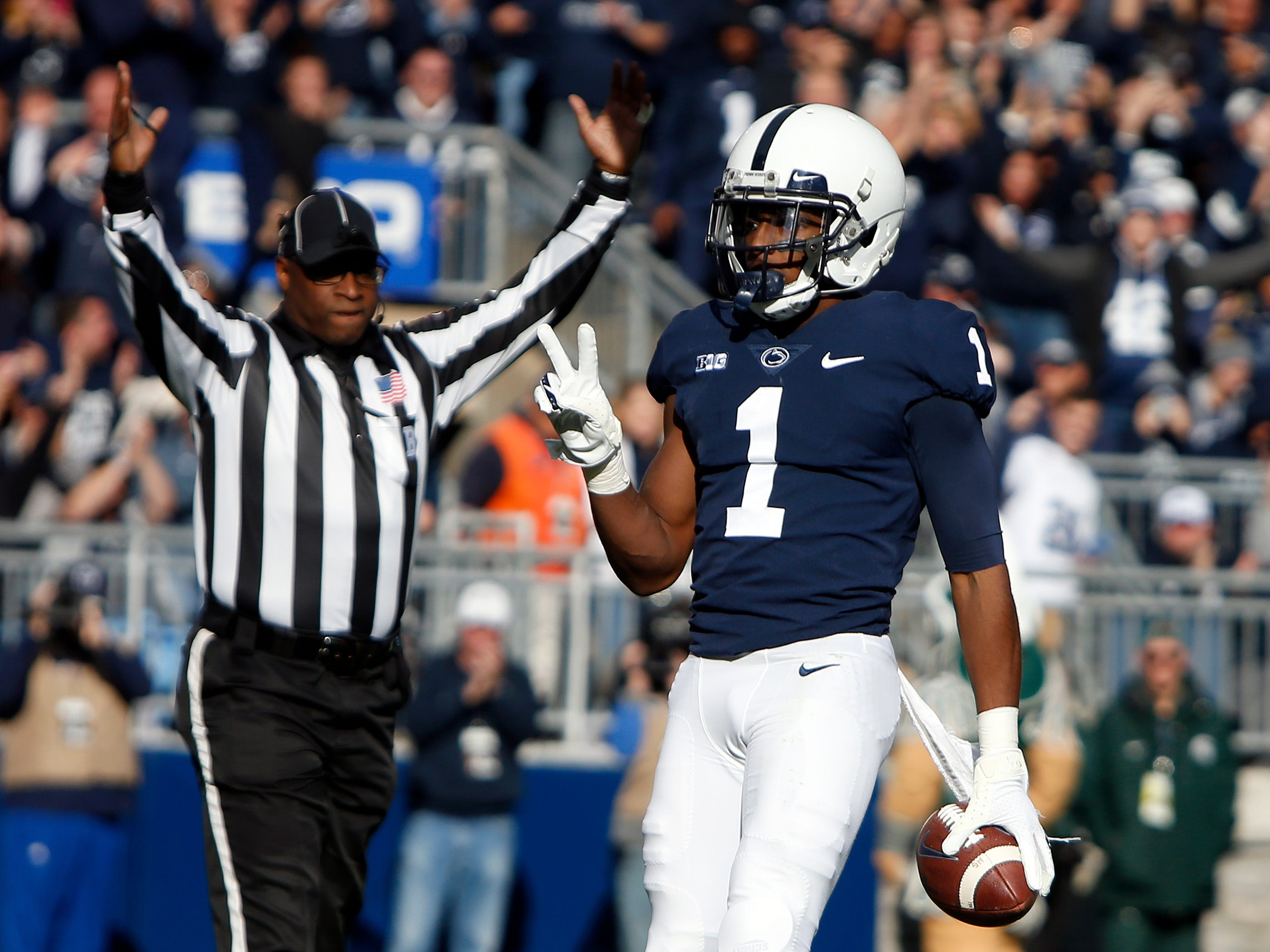 KJ Hamler celebrates after catching a 5-yard touchdown pass in the first half.