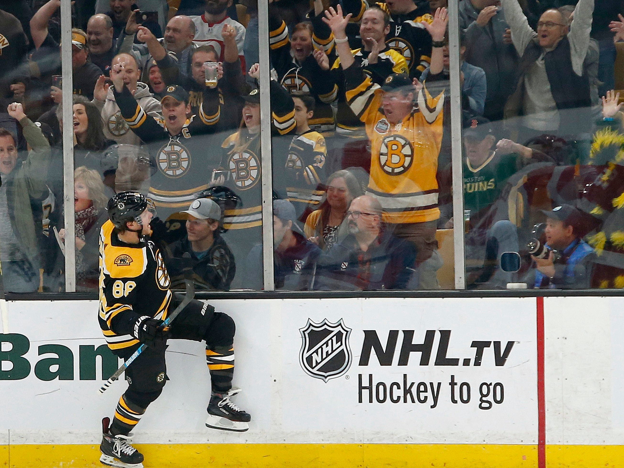 Boston Bruins right wing David Pastrnak (88) reacts after scoring during the first period.
