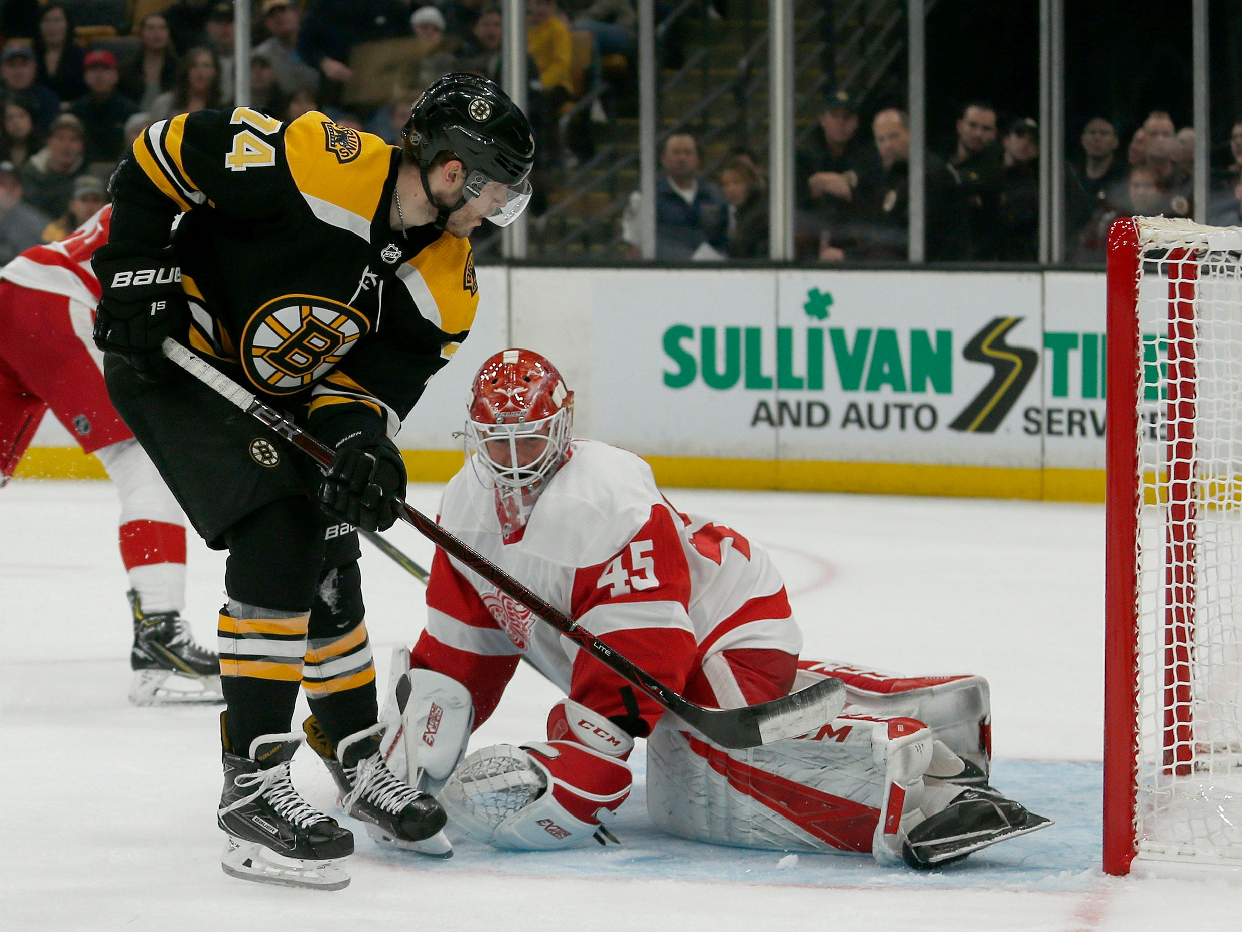 Boston Bruins left wing Jake DeBrusk (74) scores a goal past Detroit Red Wings goaltender Jonathan Bernier (45) during the second period.