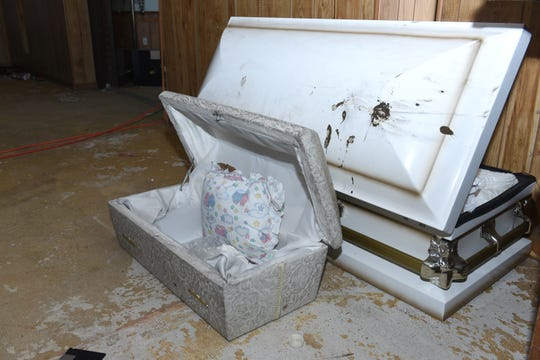 The small casket where some of the remains of the 11 infants were found  hidden in a ceiling compartment were still inside the former Cantrell Funeral Home on Saturday.