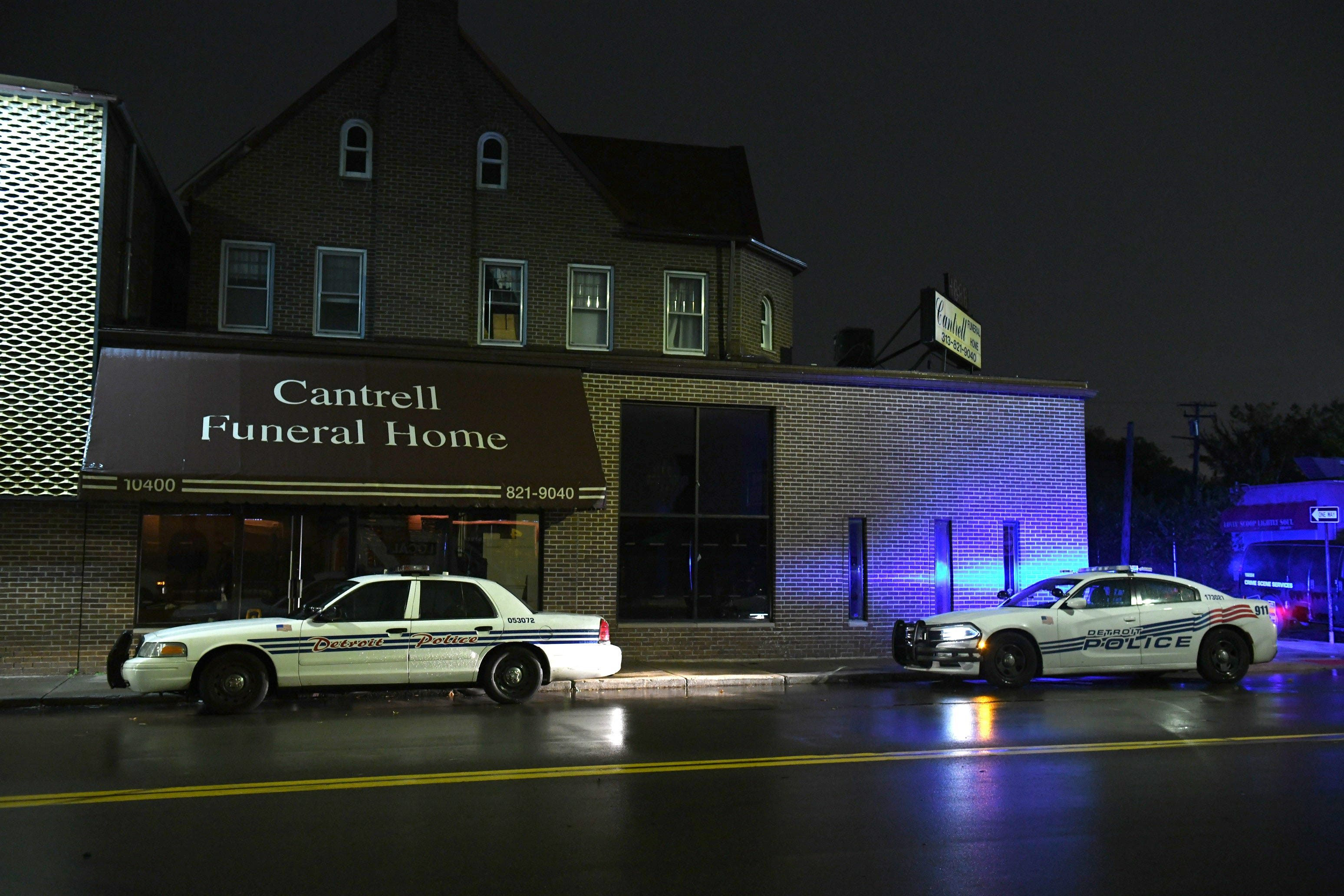 Late Friday, Detroit police vehicles park outside the now vacant Cantrell Funeral Home.