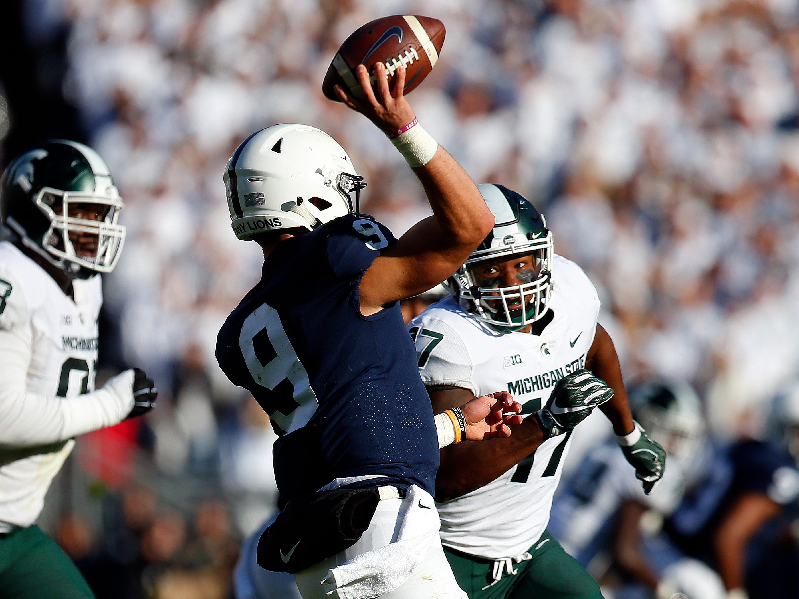 Penn State quarterback Trace McSorley  is pressured by Tyriq Thompson.