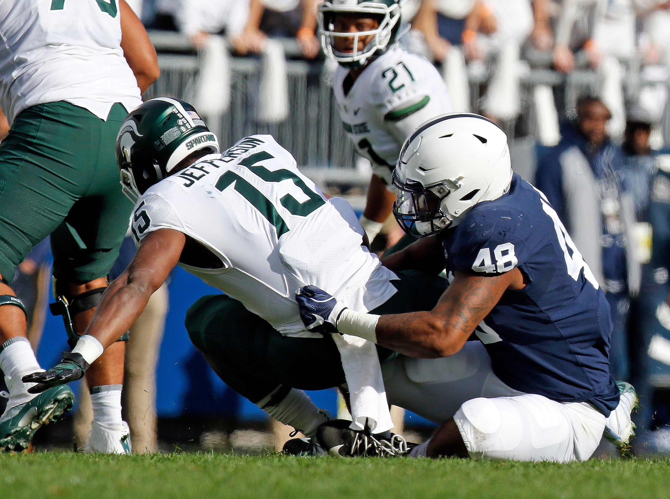 STATE COLLEGE, PA - OCTOBER 13:  Shareef Miller #48 of the Penn State Nittany Lions tackles La'Darius Jefferson #15 of the Michigan State Spartans on October 13, 2018 at Beaver Stadium in State College, Pennsylvania.  (Photo by Justin K. Aller/Getty Images)