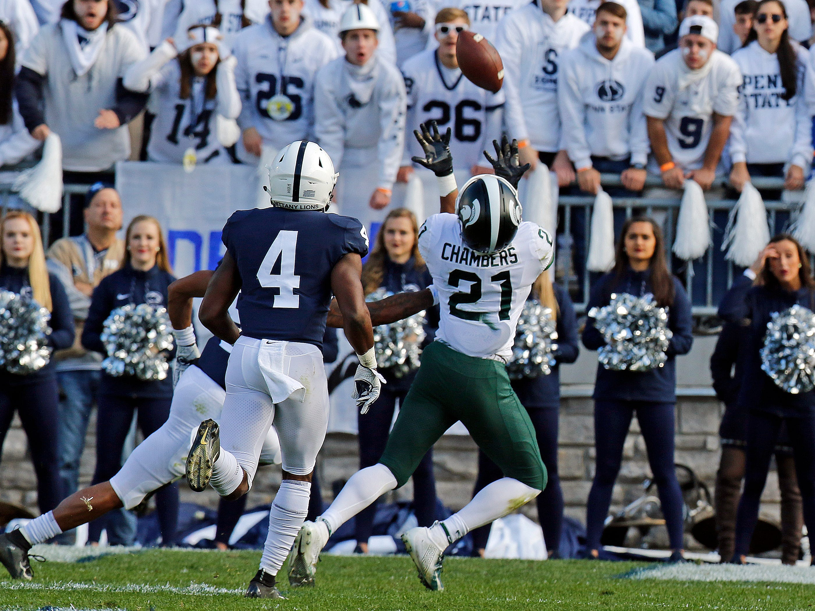 STATE COLLEGE, PA - OCTOBER 13:  Cam Chambers #21 of the Michigan State Spartans pulls in a catch against Nick Scott #4 of the Penn State Nittany Lions on October 13, 2018 at Beaver Stadium in State College, Pennsylvania.  (Photo by Justin K. Aller/Getty Images)