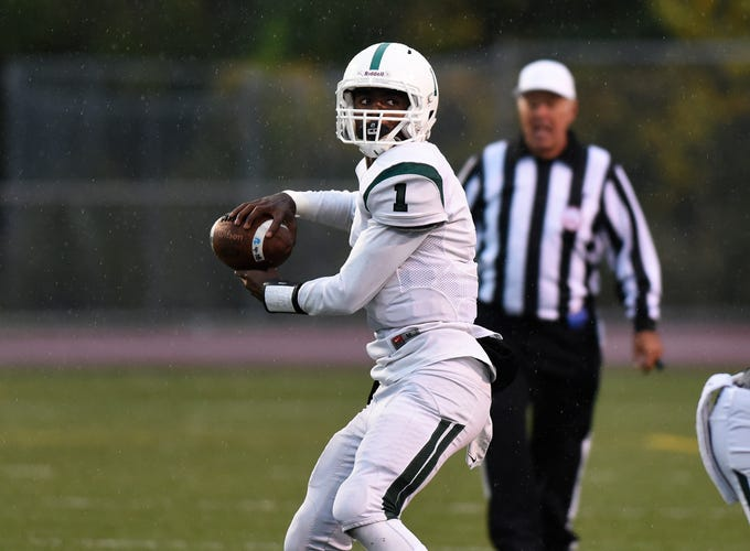 West Bloomfield quarterback Christopher Harris (1) throws against Oak Park during the first quarter, Friday, Oct. 12, 2018 at Oak Park HS in Oak Park, Mich.
