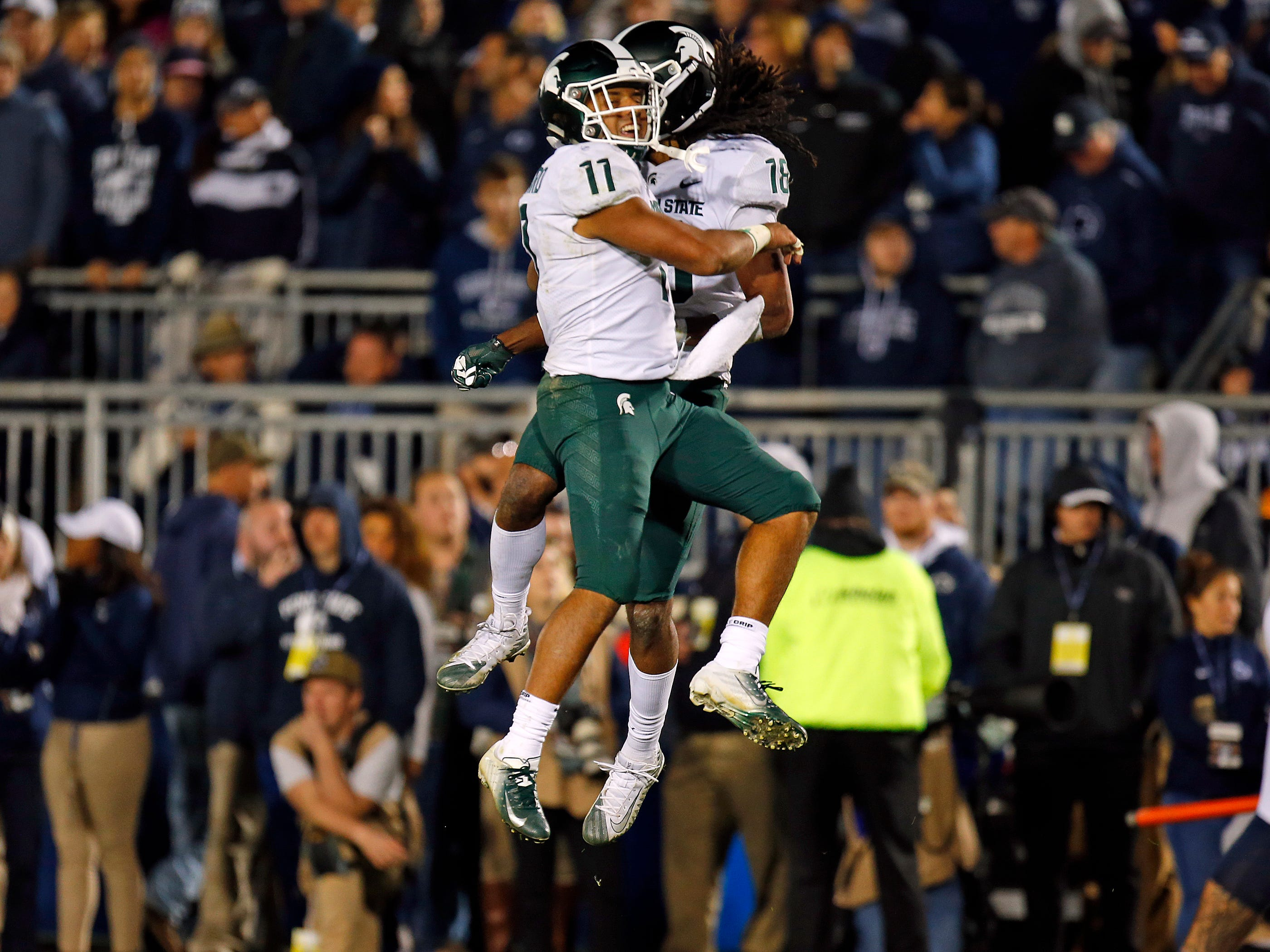 STATE COLLEGE, PA - OCTOBER 13:  Felton Davis III #18 of the Michigan State Spartans celebrates with Connor Heyward #11 of the Michigan State Spartans after catching a 25 yard touchdown pass in the fourth quarter against the Penn State Nittany Lions on October 13, 2018 at Beaver Stadium in State College, Pennsylvania.  (Photo by Justin K. Aller/Getty Images)