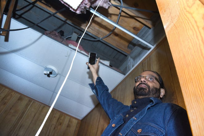 Naveed Syed, owner of the building that once housed the Cantrell Funeral Home, shows the location where the remains of 11 infants were found hidden in a ceiling compartment.
