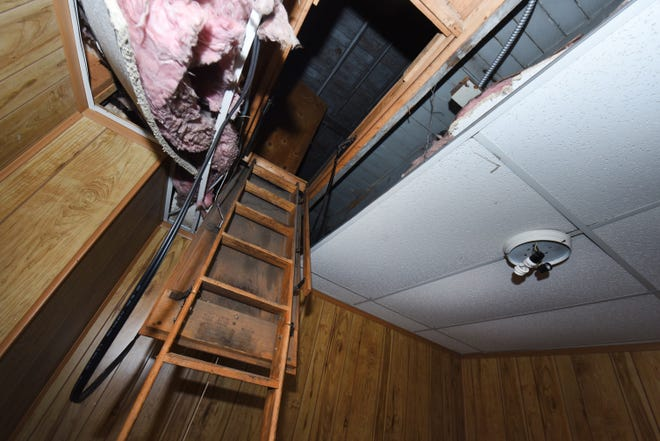 The ceiling compartment where the remains of 11 infants were found hidden inside the former Cantrell Funeral Home.
