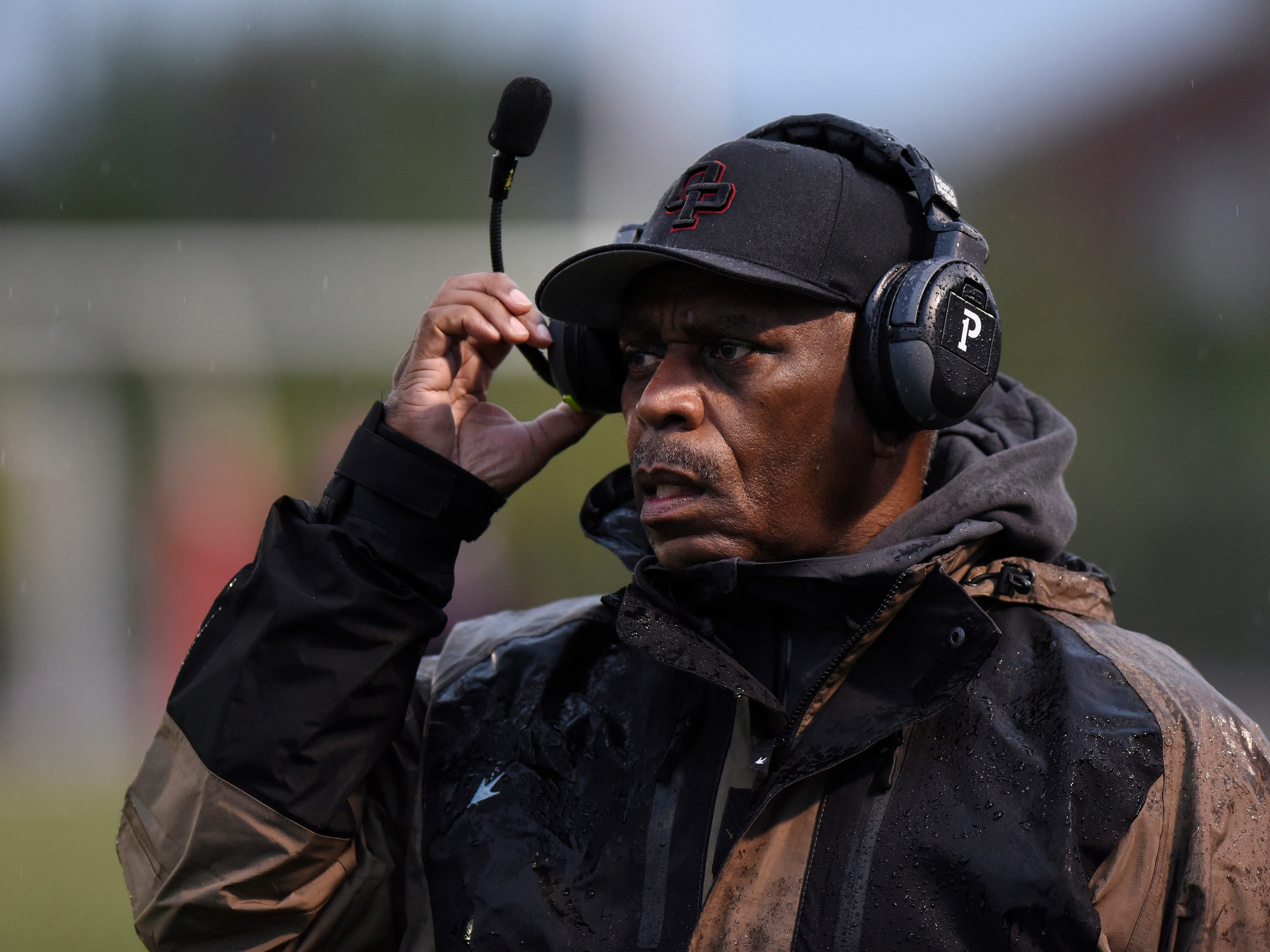 Oak Park head coach Greg Carter waches his team play against West Bloomfield during the first quarter.