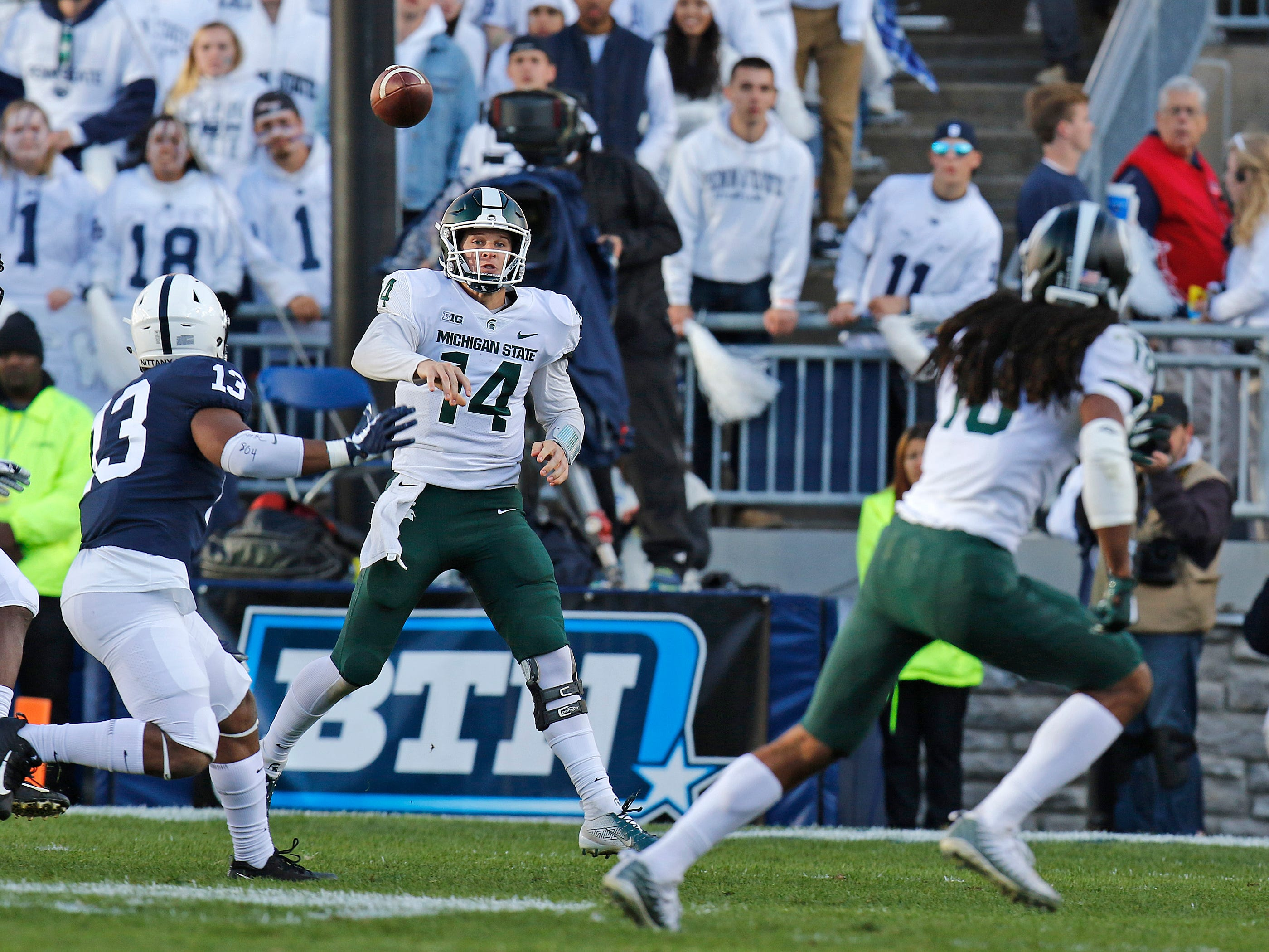 STATE COLLEGE, PA - OCTOBER 13:  Brian Lewerke #14 of the Michigan State Spartans passes against the Penn State Nittany Lions on October 13, 2018 at Beaver Stadium in State College, Pennsylvania.  (Photo by Justin K. Aller/Getty Images)