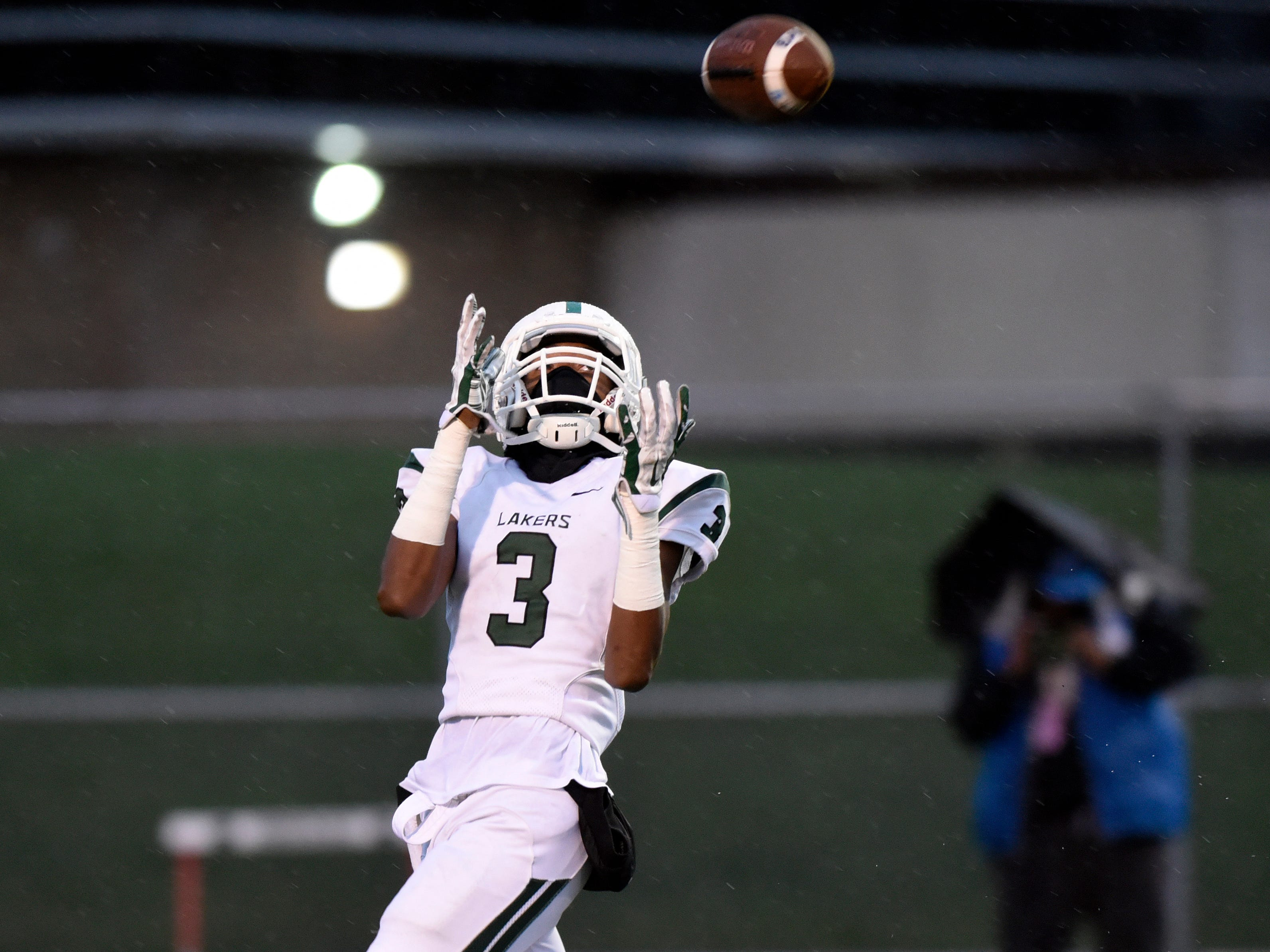 West Bloomfield wide receiver Tyrone Broden (3) hauls in a pass and runs for a touchdown against Oak Park during the first quarter.