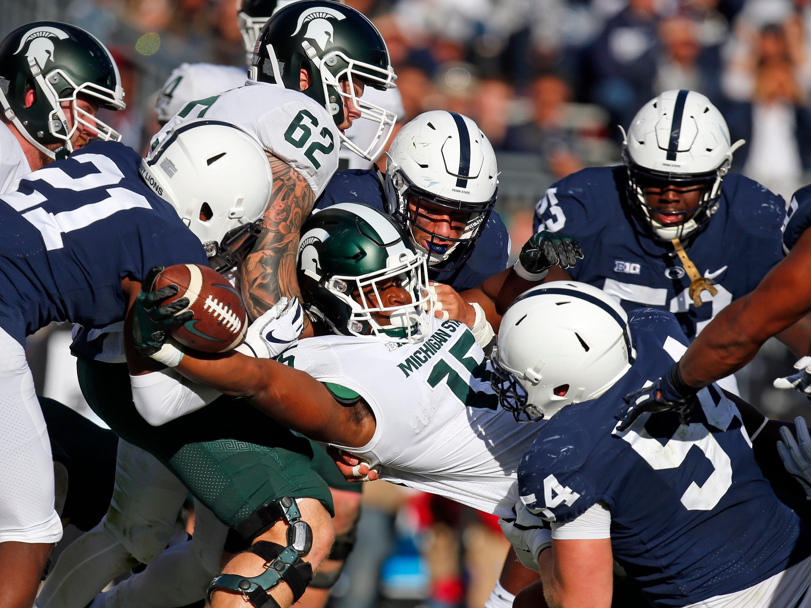 Michigan State's La'Darius Jefferson eaches for a 1-yard touchdown run in the first half against Penn State on Saturday, Oct. 13, 2018, at Beaver Stadium in State College, Pa.