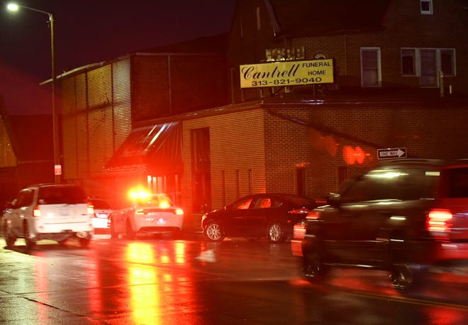 Detroit Police are on the scene at the former Cantrell Funeral Home on Mack Avenue. The remains of 11 infants were found in the ceiling of the building on the city's east side Friday, police say.