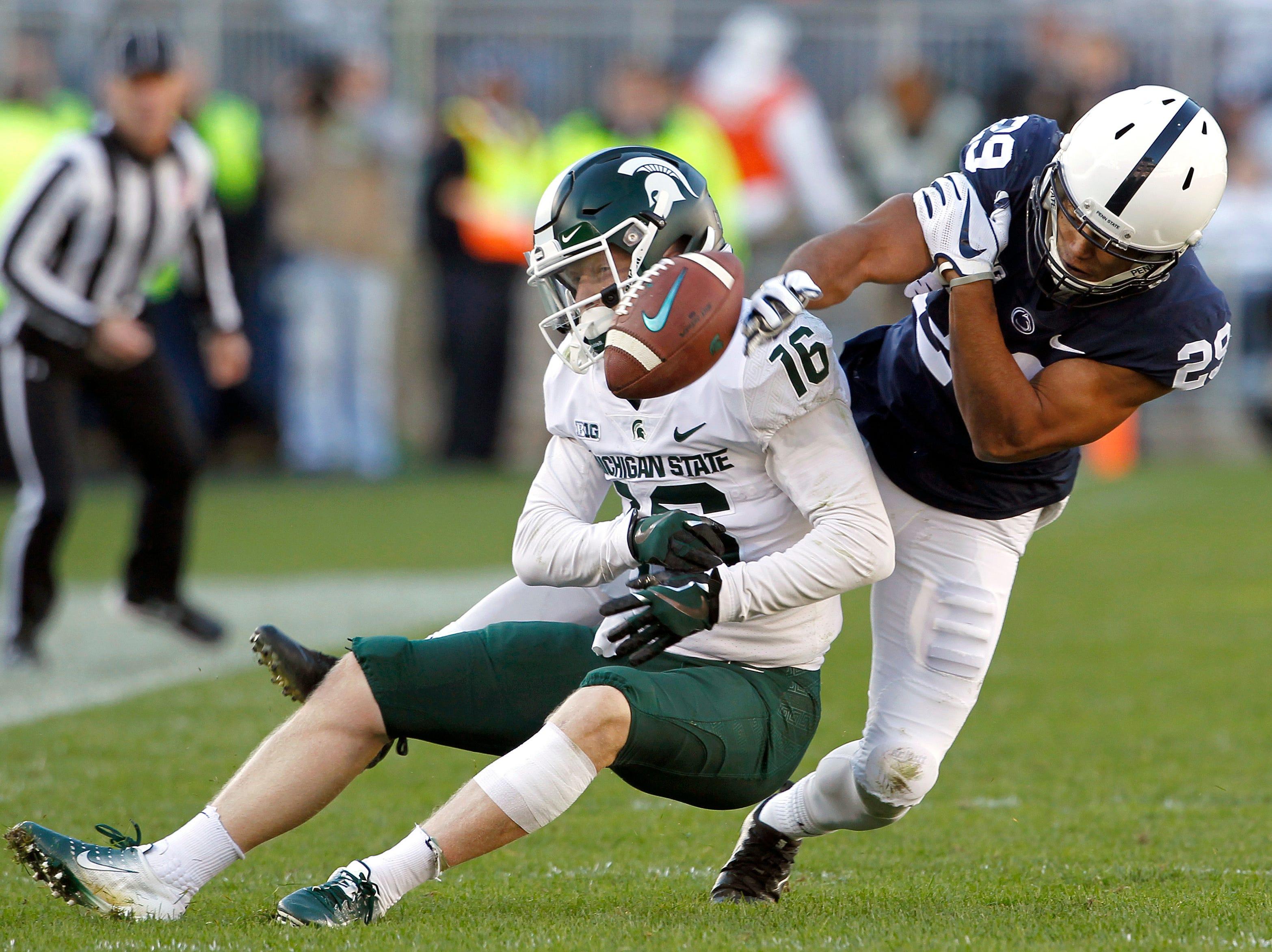 Penn State's John Reid breaks up a pass intended for Michigan State's Brandon Sowards.