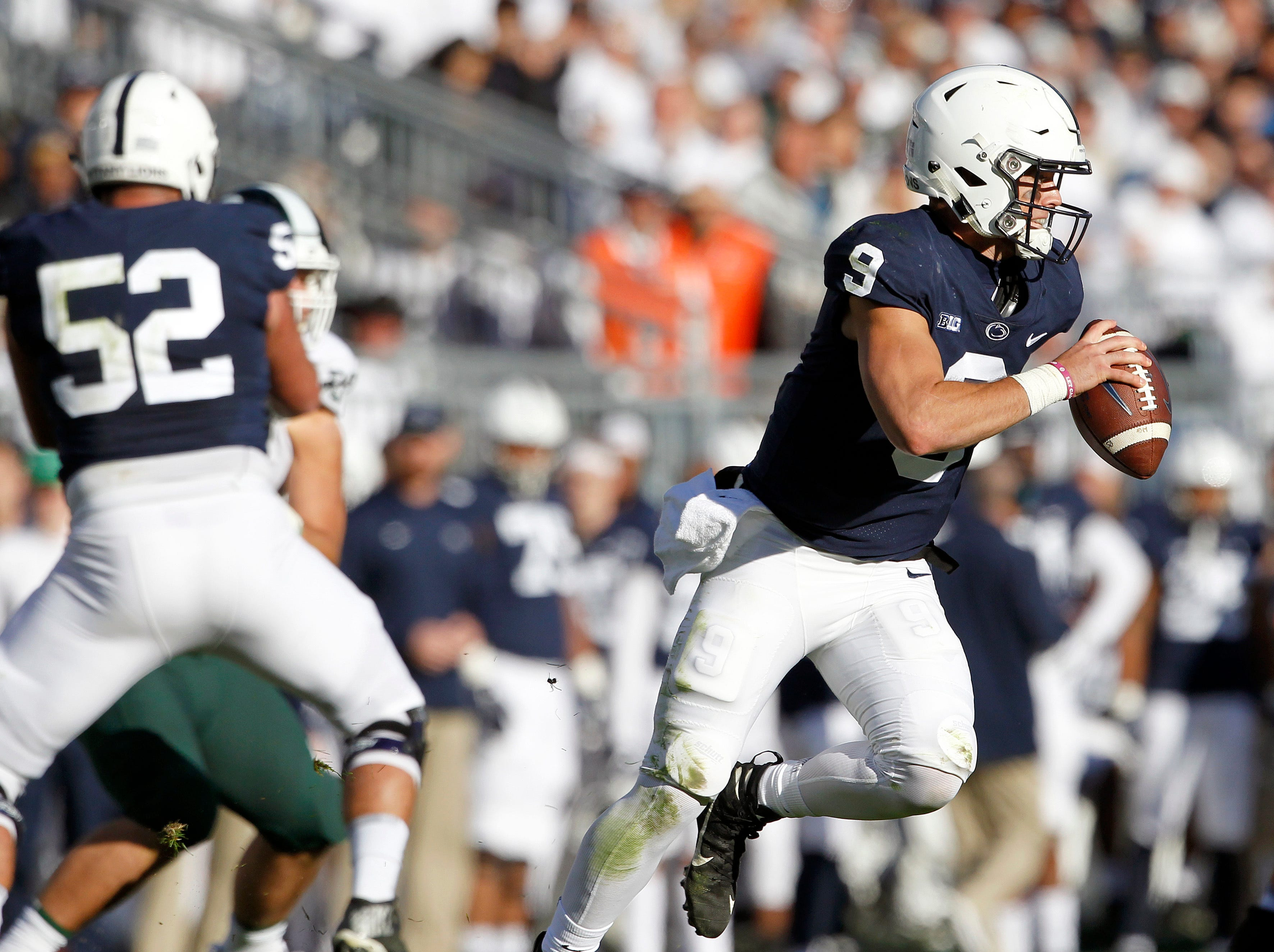 Penn State quarterback Trace McSorley rolls out of the pocket looking to pass.
