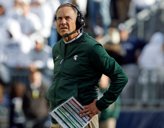 Michigan State head coach Mark Dantonio looks on from the sidelines during the Penn State game.