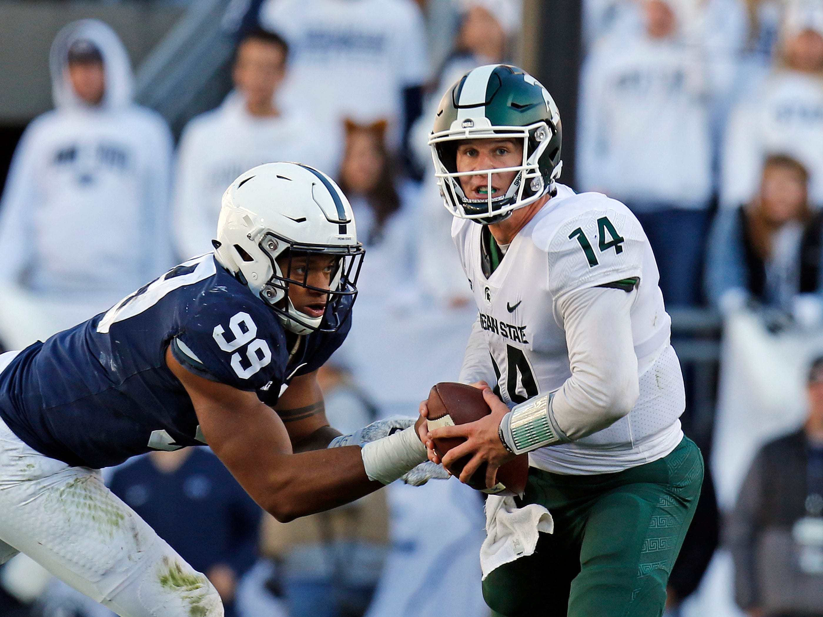 STATE COLLEGE, PA - OCTOBER 13:  Yetur Gross-Matos #99 of the Penn State Nittany Lions hurries Brian Lewerke #14 of the Michigan State Spartans on October 13, 2018 at Beaver Stadium in State College, Pennsylvania.  (Photo by Justin K. Aller/Getty Images)