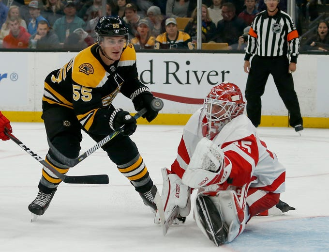 Boston Bruins center Noel Acciari (55) tries to score as Detroit Red Wings goaltender Jonathan Bernier (45) makes a save during the second period of an 8-2 Bruins victory Saturday, Oct. 13, 2018, in Boston.