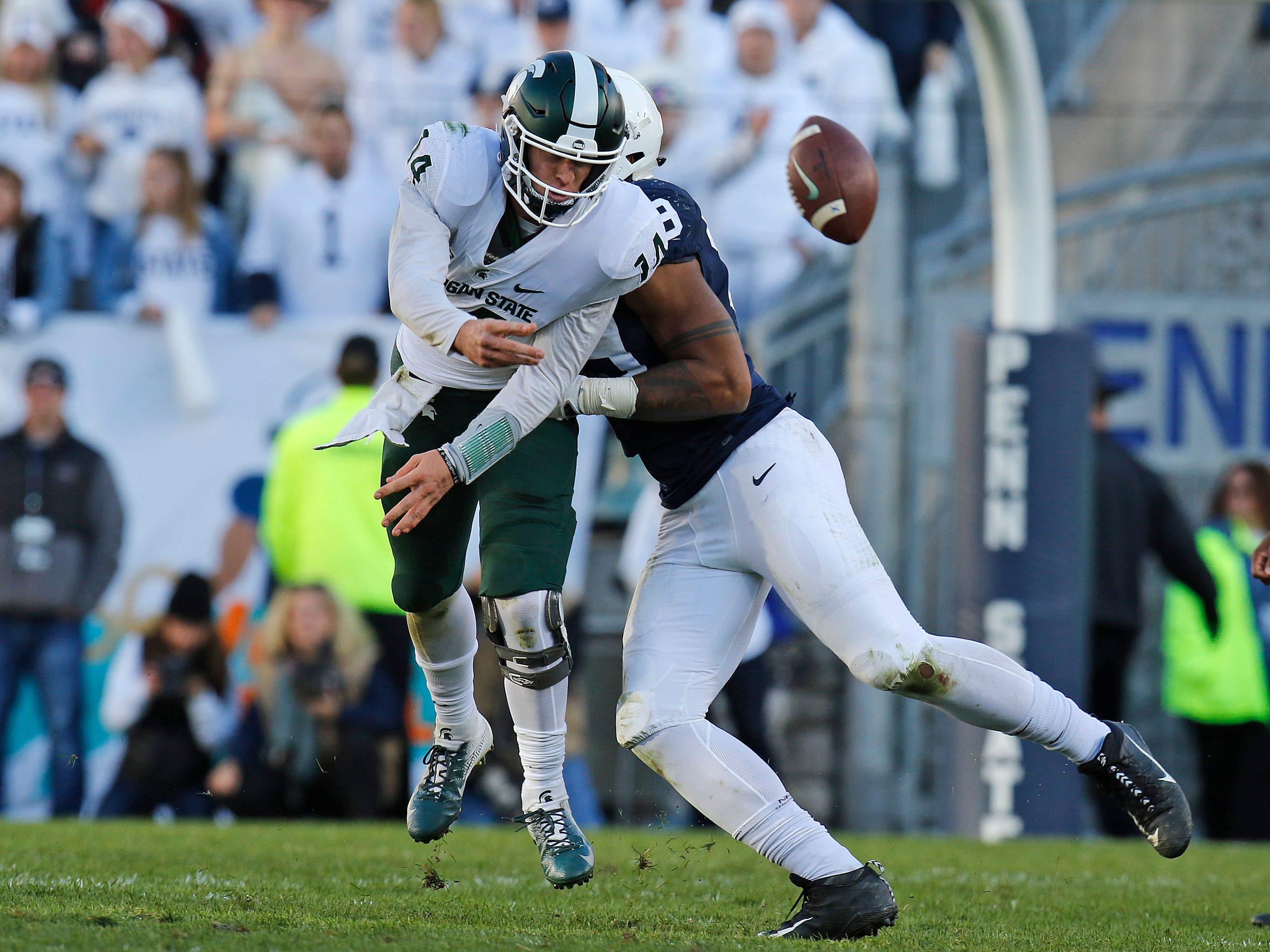 Penn State's Yetur Gross-Matos hurries Michigan State quarterback Brian Lewerke.