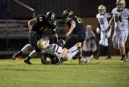 Mount Carmel's Zeke Hadra is tackled by Boonville's Reed Overton (30) during the Boonville vs Mount Carmel game at Bennett Field Friday, Oct. 12, 2018.