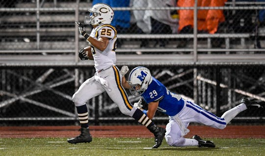 Castle's Noah Taylor (25) picks up yardage along the side line as the Memorial Tigers play the Castle Knights at Evansville's Enlow Field Friday, October 12, 2018.