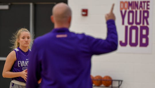 University of Evansville Aces guard Brooke Dossett listens to head coach Matt Ruffing during team practice at the Carson Center Thursday. The grad student has been diagnosed with multiple sclerosis, after receiving a medical red shirt she hopes to continue to play and inspire others who have MS, October 11, 2018.