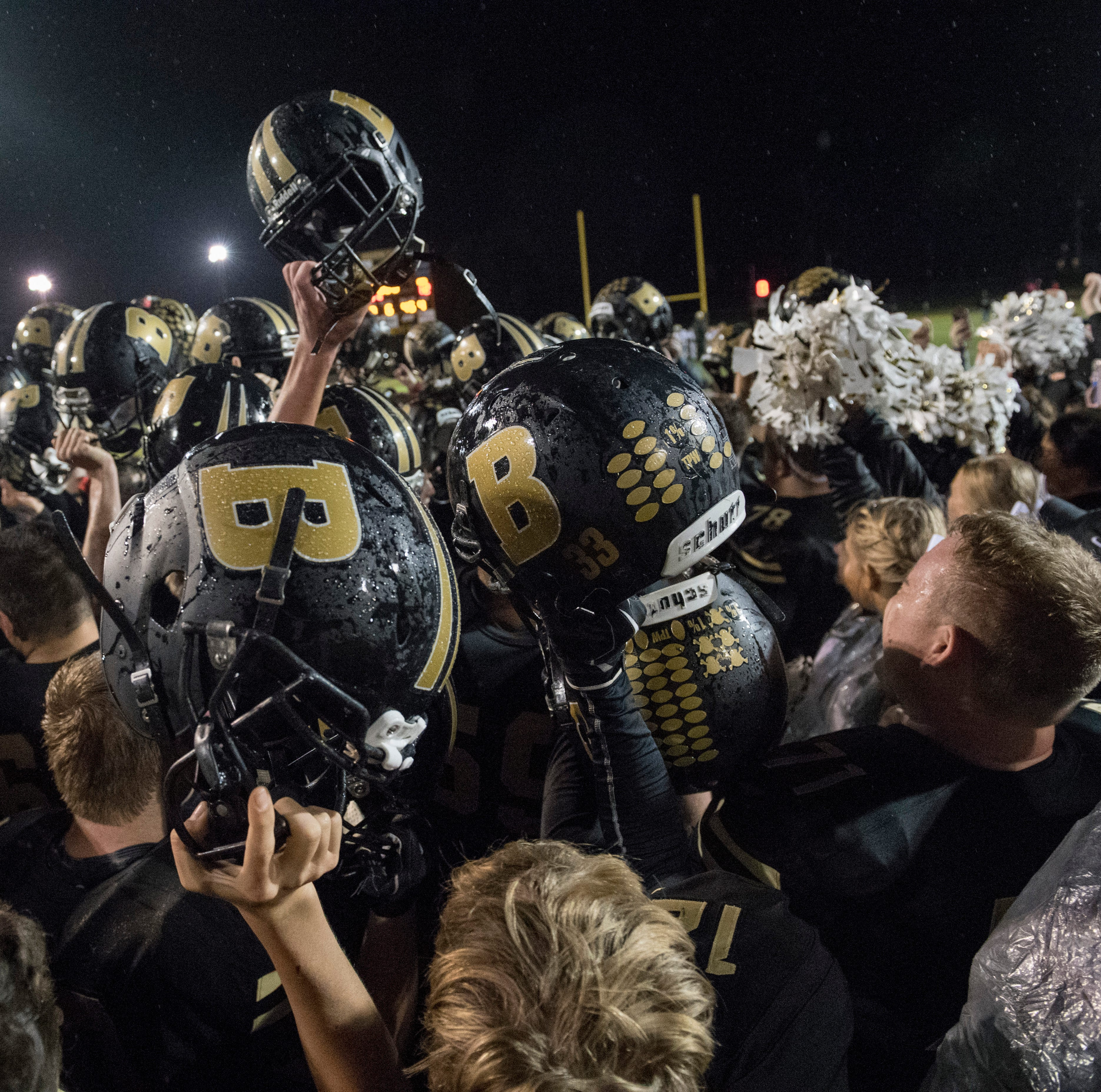 The Boonville Pioneers celebrate finishing the regular season undefeated after beating the Mount Carmel Golden Aces at Bennett Field Friday, October 12, 2018.