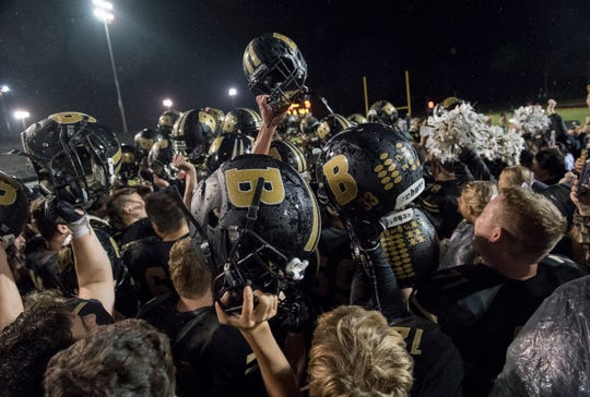 The Boonville Pioneers celebrate finishing the regular season undefeated after beating the Mount Carmel Golden Aces at Bennett Field. With Mount Carmel now leaving the Big Eight, it leaves a problem with the remaining football schools.