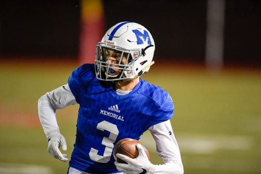 Memorial's Colton Pence (3) picks up yardage as the Memorial Tigers play the Castle Knights at Evansville's Enlow Field Friday, October 12, 2018.