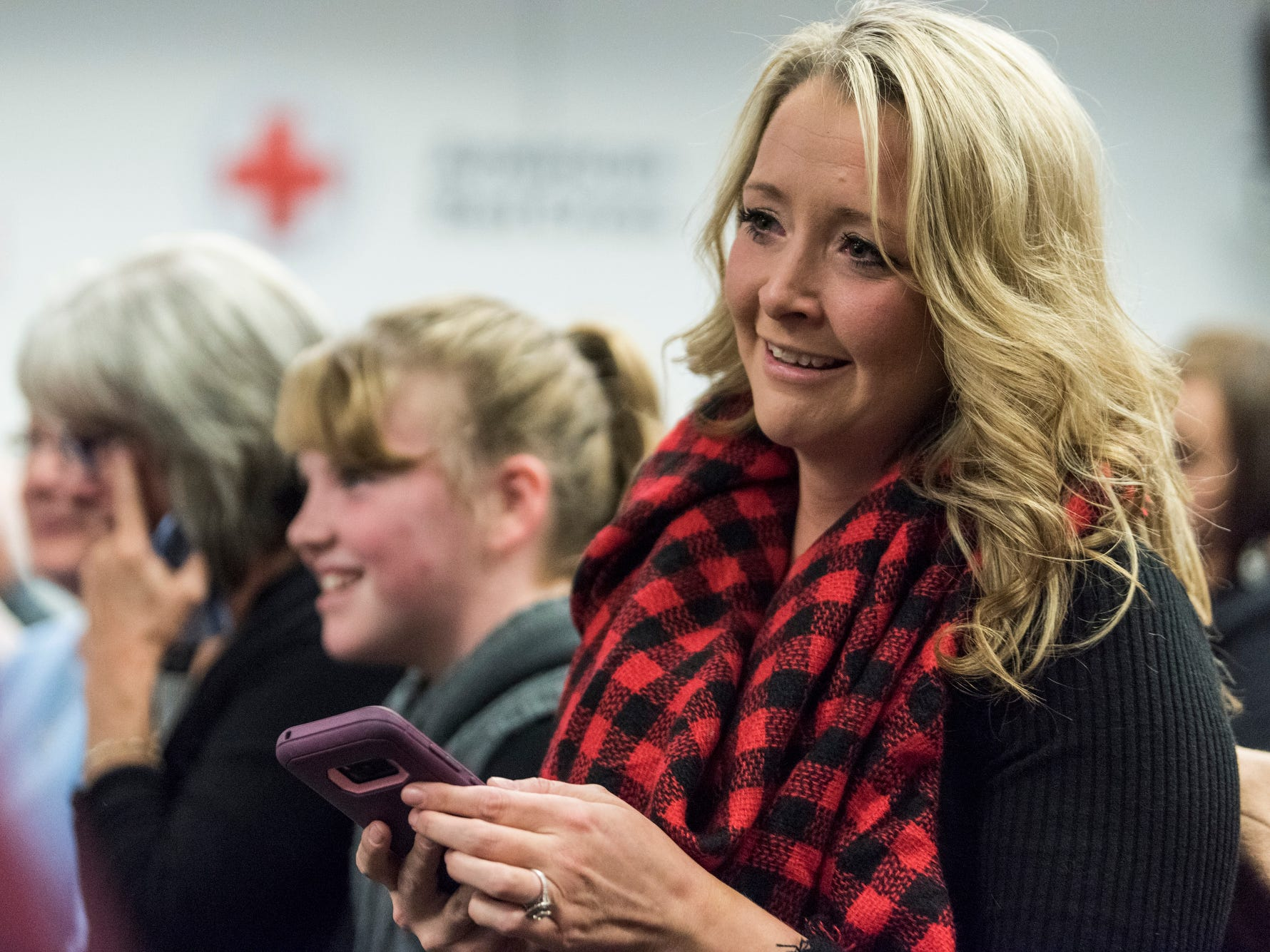 """Jessica Schmitt reacts to her fiancé Ryan Lux being named the Distinguished Recruit of during his Evansville Fire Department graduation ceremony at the American Red Cross Headquarters in Evansville, Ind., Friday, Oct. 12, 2018. """"I am so proud of him. I was overwhelmed with emotion, I immediately started bawling,"""" Schmitt said."""
