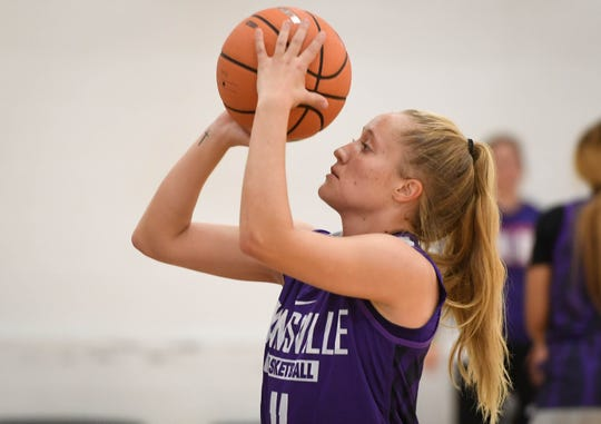 University of Evansville Aces guard Brooke Dossett shoots free throws during team practice at the Carson Center Thursday. The grad student has been diagnosed with multiple sclerosis, after receiving a medical red shirt she hopes to continue to play and inspire others who have MS, October 11, 2018.