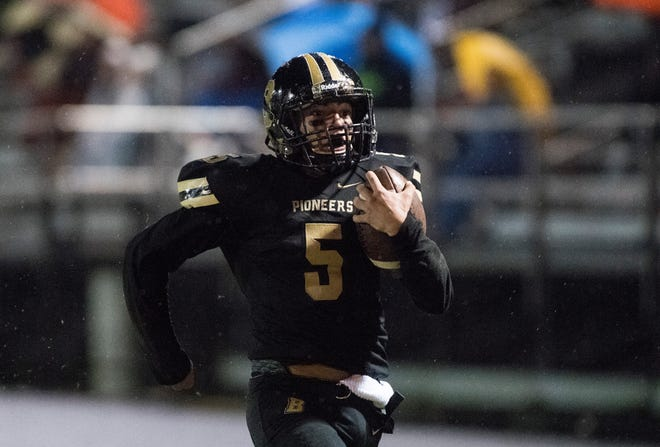 Boonville's Devin Mockobee (5) runs the ball in for a touchdown during the Boonville vs Mount Carmel game at Bennett Field Friday, Oct. 12, 2018. The Pioneers beat the Golden Aces 40-12 earning the Big Eight title.