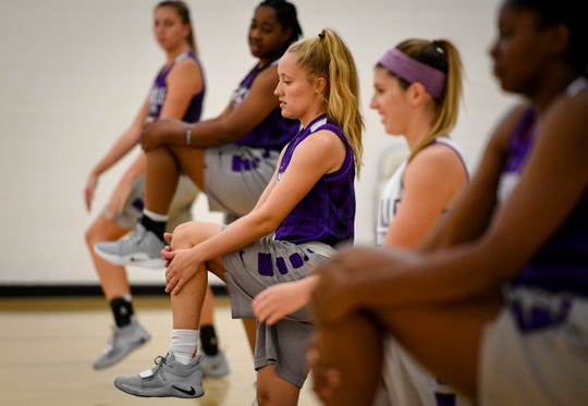 University of Evansville Aces guard Brooke Dossett goes through team warmup drills during practice at the Carson Center Thursday. The grad student has been diagnosed with multiple sclerosis, after receiving a medical red shirt she hopes to continue to play and inspire others who have MS, October 11, 2018.