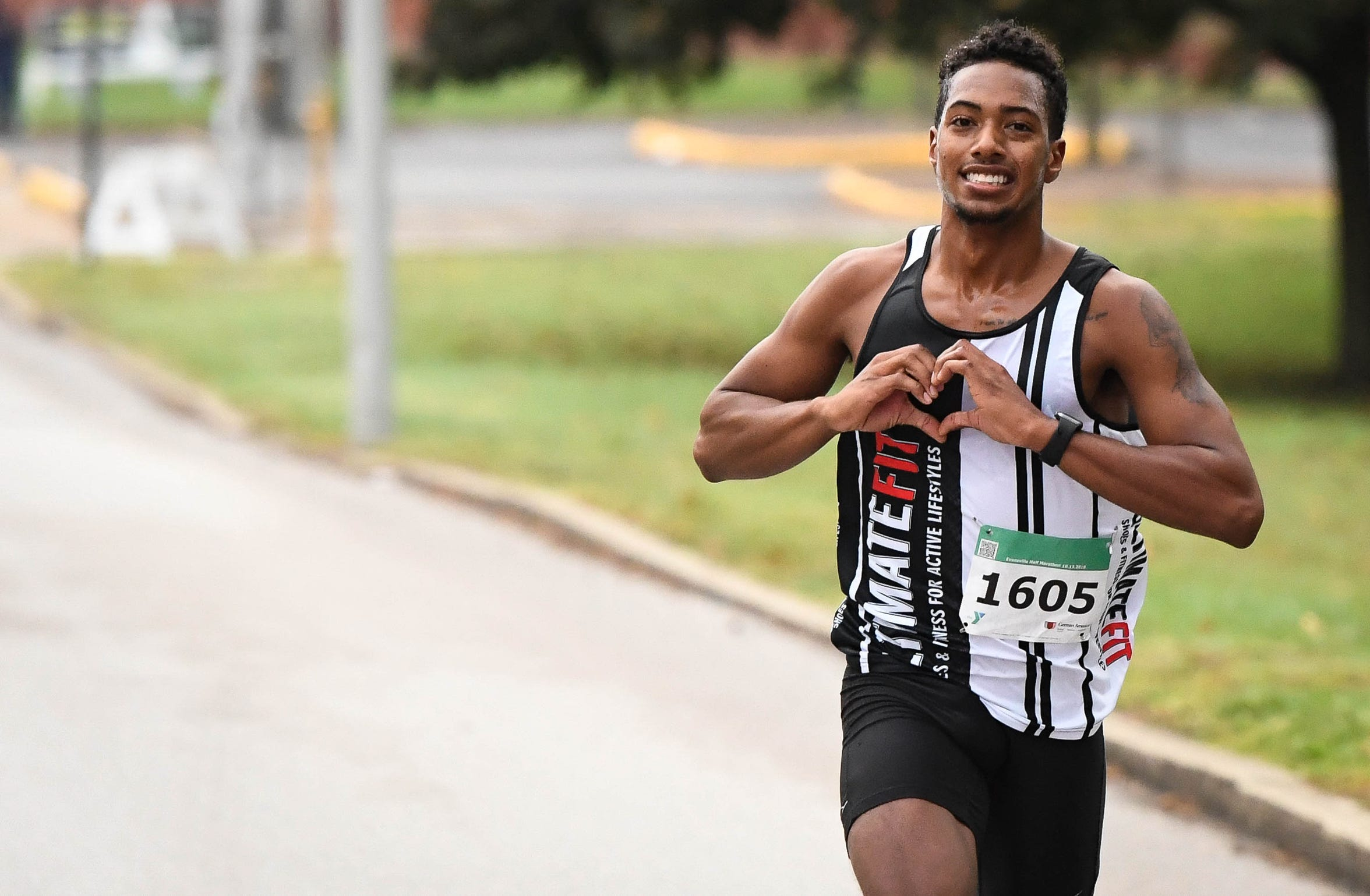 Race winner Darin Lawrence, Evansville, runs past Garvin Park on his way to a time of 1:10:06 at the the Evansville Half Marathon Saturday morning, October 13, 2018.