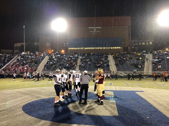 It was a rainy night at the Reitz Bowl for the annual West Side Nut Club rivalry game.