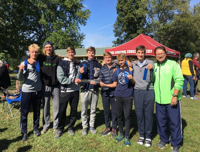 The Reitz boys' cross country team poses with its first-ever regional championship plaque Saturday in Petersburg.
