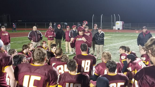 Gibson Southern football head coach Nick Hart addresses his team following a 31-14 win over Southridge on Friday night.