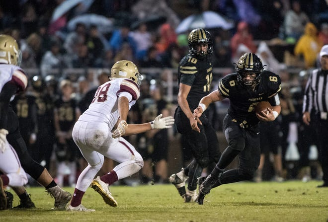 Boonville's Luke Conner (6) carries the ball during the Boonville vs Mount Carmel game at Bennett Field Friday, Oct. 12, 2018. The Pioneers beat the Golden Aces 40-12 earning the Big Eight title.