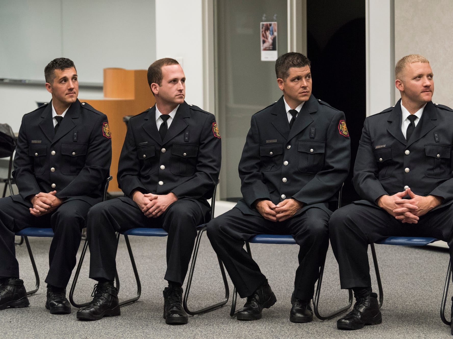 A graduation ceremony is held for new probationary Evansville Firefighters Ryan Lux, from left, Jesse Marx, Cameron Harris and Michael Wilson at the American Red Cross Headquarters in Evansville, Ind., Friday, Oct. 12, 2018.