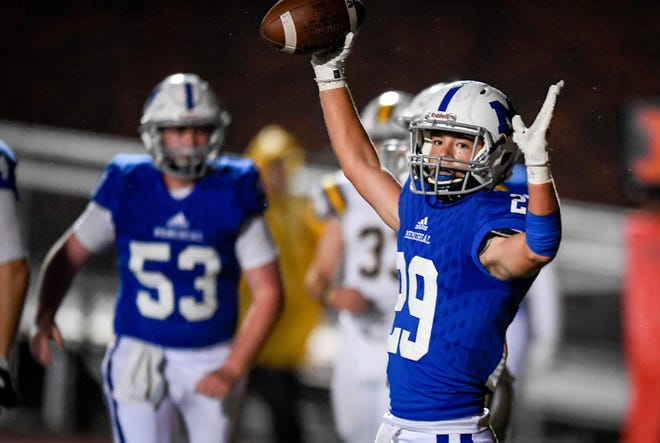 Memorial's Finn McCool (29) celebrates a touchdown against Castle on October 12, 2018. The Tigers are now in Class 4A following back-to-back trips to the state championship game.