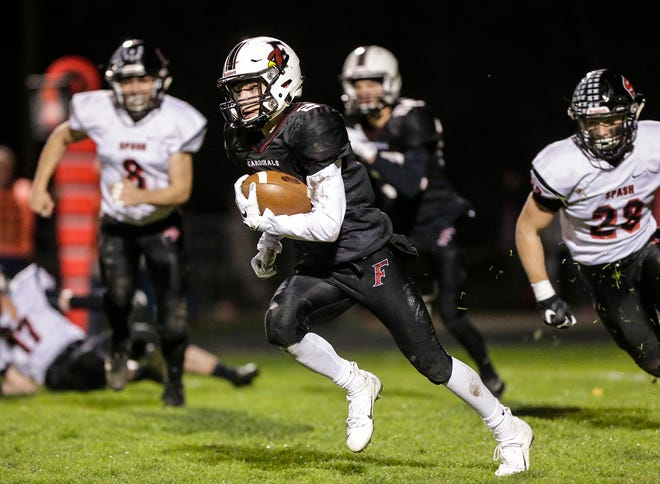 Fond du Lac's Eben Sauer runs against Stevens Point during their game Oct. 12 at Fruth Field in Fond du Lac. The team finished the regular season undefeated.