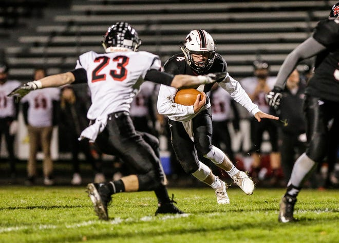 Fond du Lac's Carson Raddatz runs the ball against Stevens Point's Nate Engelkes on Friday. Fond du Lac is the top-ranked team in the state in the last AP state poll of the season.